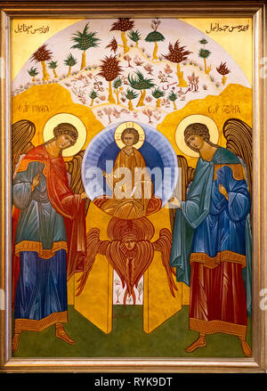 Icon in the Nazareth melkite (Greek catholic) chuch, Galilee, Israel. Jesus surrounded by archangels Michael and Gabriel. - Stock Photo