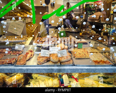 BERGAMO, ITALY - FEBRUARY 23, 2019: window of bakery and pastry shop with traditional local products in Citta Alta (Upper Town) of Bergamo city, Lomba - Stock Photo
