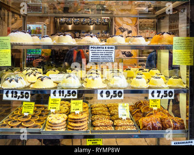 BERGAMO, ITALY - FEBRUARY 23, 2019: window of pastry store with traditional local products including Polenta e osei dish in Citta Alta (Upper Town) of - Stock Photo