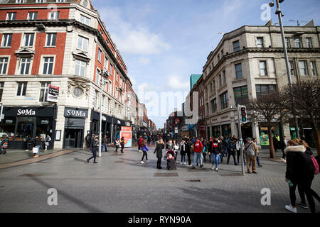 Looking down north earl street from oconnell street Dublin Republic of Ireland Europe - Stock Photo