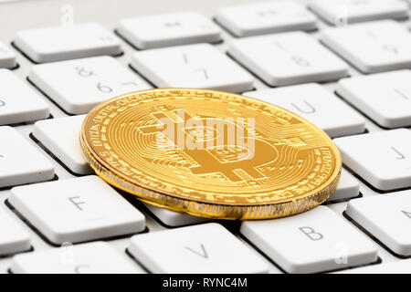 cryptocurrency, virtual currency  bitcoin, on keyboard - Stock Photo