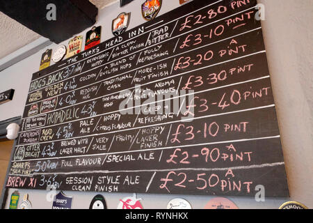 Blackboard showing the names and prices of a selection of real ales, in a Turks Head Inn micropub in Gloucester, England, UK. - Stock Photo