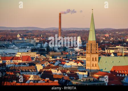 Panorama of Bielefeld, Germany with the Nikolaikirche and a smoking chimney - Stock Photo