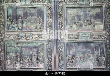 Relief, entrance door, Cathedral of Pisa, west facade, Pisa, Tuscany, Italy - Stock Photo