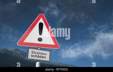 Warning sign against blue sky with clouds, warning against radiation, Germany - Stock Photo