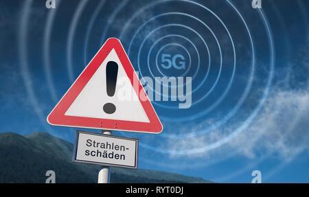 Warning sign of blue sky, warning of 5G radiation, 5G network, Germany - Stock Photo