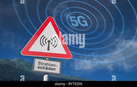 Warning sign against blue sky with clouds, warning against radiation, radiation damage, Germany - Stock Photo