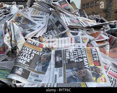 London, UK. 15th Mar, 2019. Pile of Metro newspapers in rubbish, headline 'Give May just a little more time', Brexit extension vote, 15th March 2019, London, UK Credit: Adam Mitchinson/Alamy Live News - Stock Photo