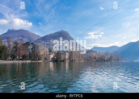 Beautiful view of Lugano lake in March, Switzerland - Stock Photo
