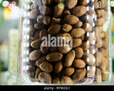 Nut mix in glass jars, hazelnuts, almonds, cashew on white background. Selective focus, copy space. - Stock Photo