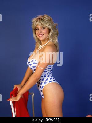Samantha Fox wearing a polkadot swimsuit - Stock Photo