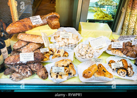 BERGAMO, ITALY - FEBRUARY 25, 2019: window of bakery and pastry shop with traditional local sweet and breads in Citta Alta (Upper Town) of Bergamo cit - Stock Photo