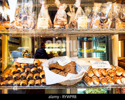 BERGAMO, ITALY - FEBRUARY 25, 2019: window of bakery with traditional local biscuits and pastries in Citta Alta (Upper Town) of Bergamo city, Lombardy - Stock Photo