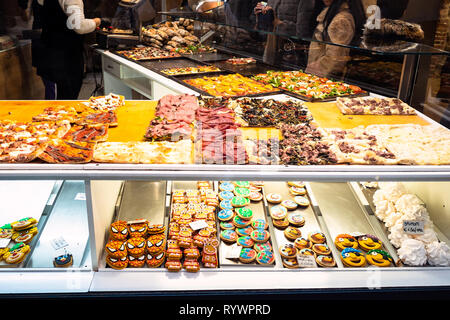BERGAMO, ITALY - FEBRUARY 25, 2019: window of bakery with local sandwiches and sweets for lunch in Citta Alta (Upper Town) of Bergamo city, Lombardy - Stock Photo