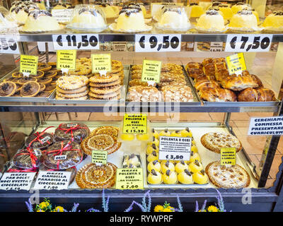 BERGAMO, ITALY - FEBRUARY 23, 2019: window of pastry bakery with traditional local sweets including Polenta e osei dish in Citta Alta (Upper Town) of  - Stock Photo