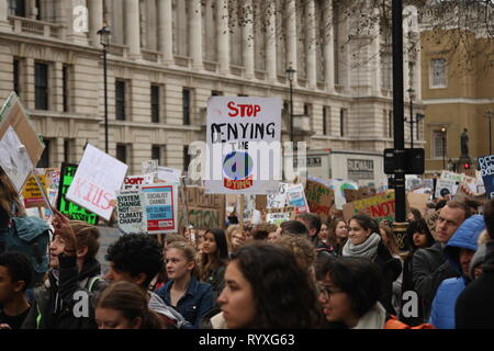 London, UK, 15th March 2019. School and college students in London take part in the second protest calling for the World's governments to make environmental issues a priority. They have walked out of school to gather outside the Houses of Parliament, and march around the capital, stopping at Buckingham Palace. It is one of many protests taking place at the same time around the country. Roland Ravenhill/Alamy Live News. - Stock Photo