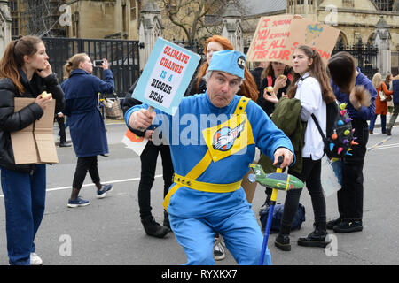 London, UK. 15th Mar, 2019. School climate strike March 15th 2019, London, Parliament Square: Swedish climate activist Greta Thunberg inspired UK students to protest climate change today by walking out of schools. Students are calling for the government to take action on global warming. Credit: Thomas Krych/Alamy Live News - Stock Photo