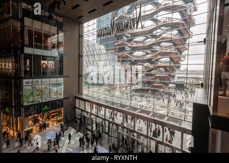 New York, USA. 15th Mar, 2019. The Vessel is seen from the lobby of the Hudson Yards mall on the West Side of Manhattan on its grand opening day, Friday, March 15, 2019. Retailers, including the Neiman Marcus department store, opened their shops in the development which was built on a platform over the West Side railroad yards. Office, residential, public space and retail space comprise the first phase in what is arguably the most expensive construction project ever built in the U.S.   (© Richard B. Levine) Credit: Richard Levine/Alamy Live News - Stock Photo