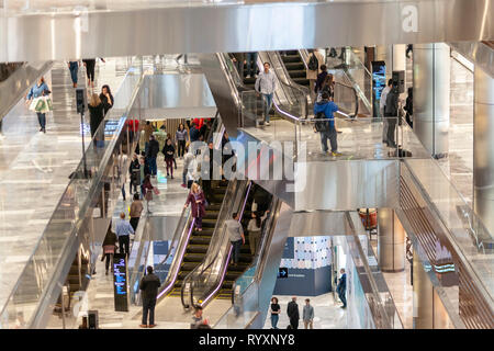 New York, USA. 15th Mar, 2019. Visitors crowd the Hudson Yards mall on the West Side of Manhattan on its grand opening day, Friday, March 15, 2019. Retailers, including the Neiman Marcus department store, opened their shops in the development which was built on a platform over the West Side railroad yards. Office, residential, public space and retail space comprise the first phase in what is arguably the most expensive construction project ever built in the U.S.   (© Richard B. Levine) Credit: Richard Levine/Alamy Live News - Stock Photo