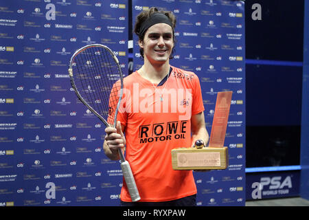 London, UK. 15th March, 2019. Paul Coll of New Zealand poses with the winners trophy after his victory. Citigold Canary Wharf Squash Classic, day 6, the Final, at the East Wintergarden in Canary Wharf , London on Friday 15th March 2019.   pic by  Steffan Bowen/Andrew Orchard sports photography/Alamy Live news - Stock Photo