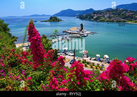 Corfu island. (Kerkyra) Greece. Beautiful Vlacherna Monastery and Mouse island. (Pontikonisi) Beautiful colorful island for summer holidays/vacation a - Stock Photo