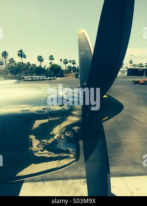 Turboprop sits on tarmac  at Palm Springs International airport - Stock Photo