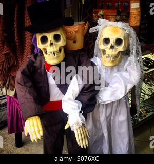 A newlywed skeletons decorate a shop for the Day of the Dead celebration in Colonia Roma, Mexico City, Mexico - Stock Photo