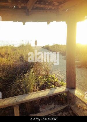 Person walking towards sea,Sanibel Island , Florida, USA - Stock Photo
