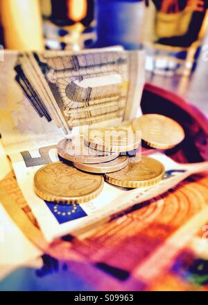 Paying a bill in Euros - Stock Photo