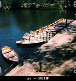 Row boats lined up at fairfield boatshed jetty, Melbourne, Australia - Stock Photo