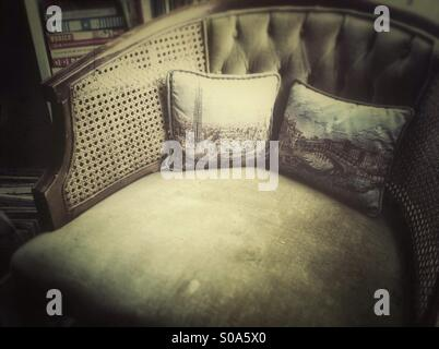 Old armchair with two pillows - Stock Photo