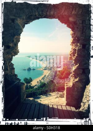 View of the beach of Blanes through a window - Stock Photo