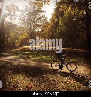 Autumn in Berlin. Cycling in Tiergarten. - Stock Photo