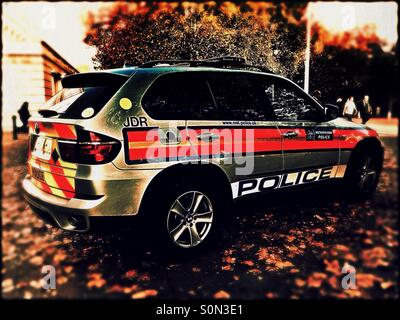 Police car on patrol, Central London, England, United Kingdom, Europe - Stock Photo