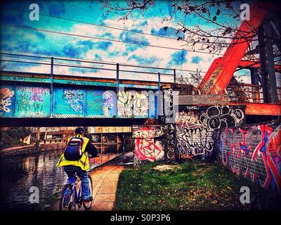 Cycling along the Grand Union Canal, Ladbroke Grove, West London, England, United Kingdom, Europe - Stock Photo