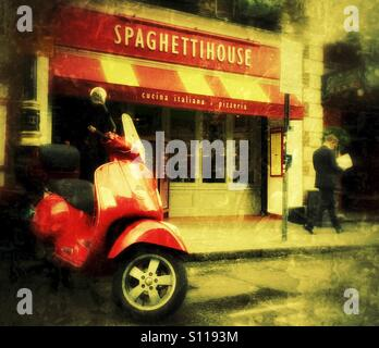 Italian Job, iconic Vespa parked in front of Spaghetti House in London's Covent Garden district - Stock Photo
