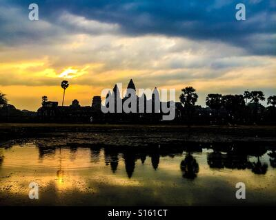 Sunrise over Angkor wat - Stock Photo