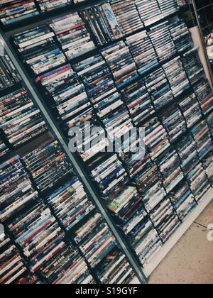 Stacks of Movie DVDs on Shelves - Stock Photo