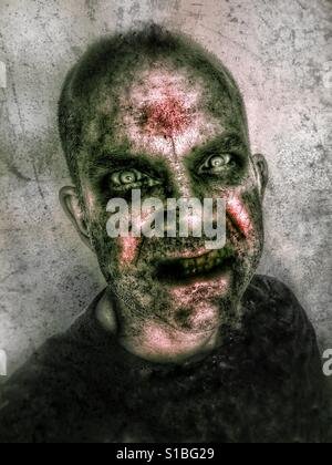 Headshot of a zombie-like man with intense eyes and rotting flesh effect. - Stock Photo