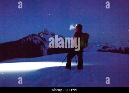 Snowshoeing at night, Elfin Lakes, BC - Stock Photo