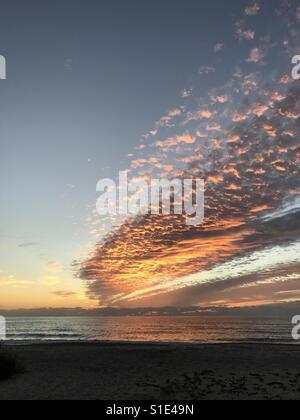 Sunset reflected on Clouds at Casey Key over Gulf of Mexico - Stock Photo