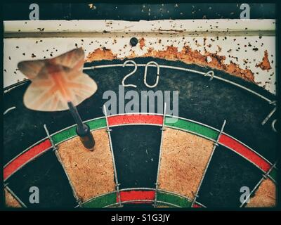 Vintage Dart Board with wear and tear. - Stock Photo
