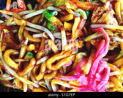 Stir fried chicken with udon noodles and pickled ginger. - Stock Photo