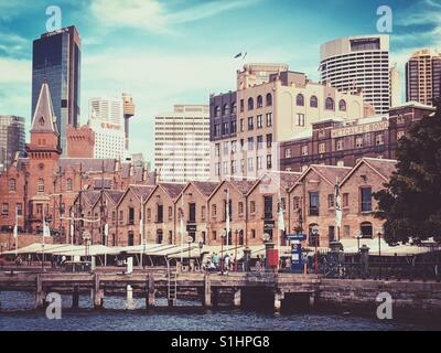 Old brick buildings lined up at The Rocks, Sydney, Australia - Stock Photo