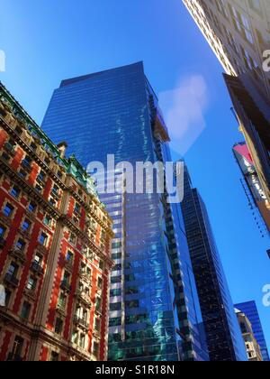 Skyscrapers and the Knickerbocker hotel shop from below, Times Square, New York City, USA - Stock Photo