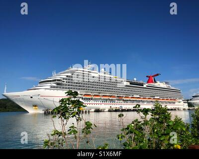 Carnival Dream Cruise Ship Docked in Mahogany Bay Cruise Port. Isla Roatan, Honduras. - Stock Photo