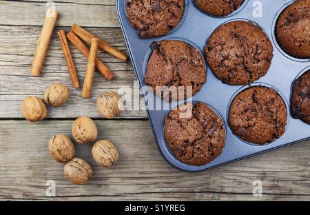 Close up of chocolate muffins on a wooden background - Stock Photo