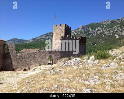 Ville de Saint-Martin-de-Londres. Medieval wall/fort in old French village. - Stock Photo