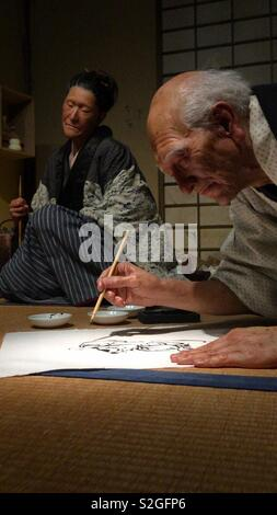 Wax models of Hokusai and his daughter Oui at the Sumida Hokusai Museum in Tokyo. - Stock Photo