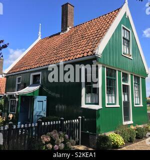 Traditional Green Wooden House in Zaanse Schans Windmill Village, Amsterdam - Stock Photo